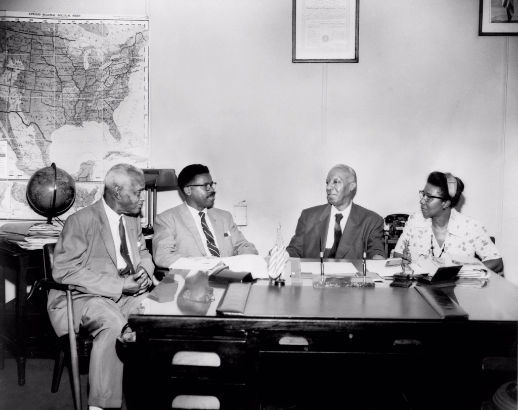Stock Photo: 4048-10544 Brotherhood of Sleeping Car Porters group. L-R: Ashley Totten, union official for the Brotherhood of Sleeping Car Porters, an unidentified man, Asa Philip Randolph, and Maida Springer-Kemp, union official for International Packing House workers. 1950s.