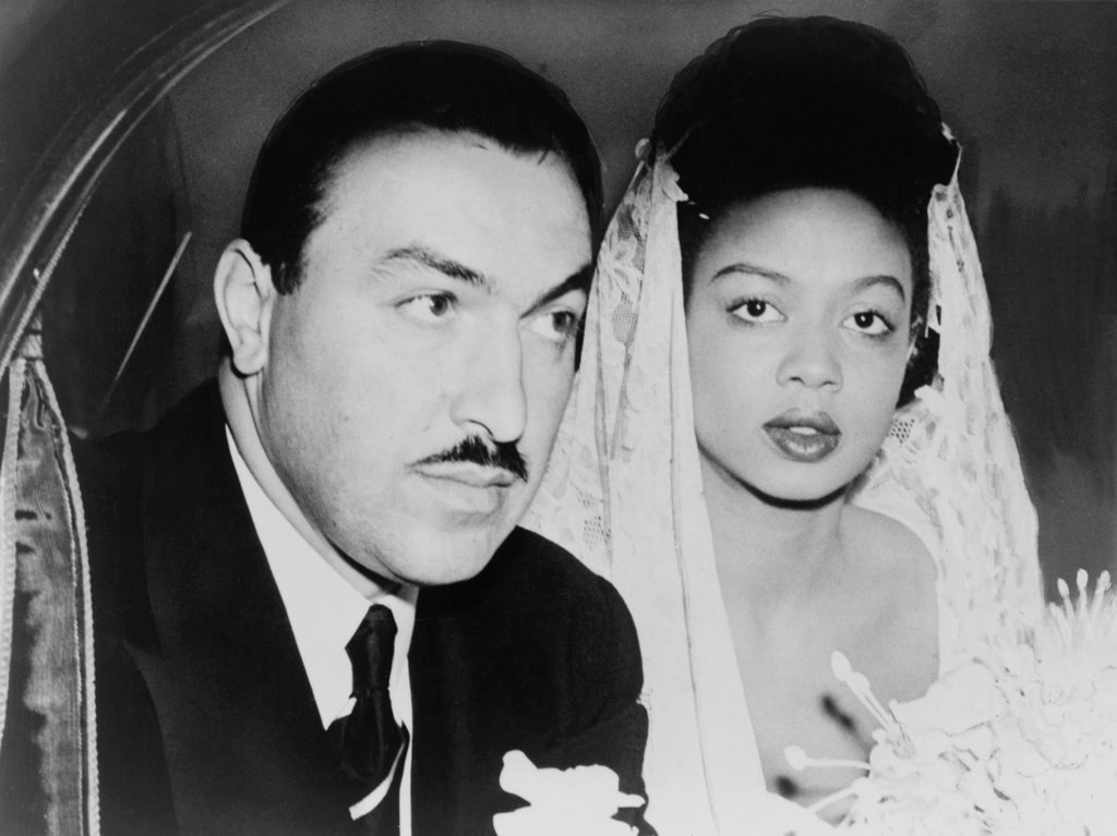 Harlem Congressman marries Jazz Singer. Adam Clayton Powell, Jr. and his bride, Hazel Dorothy Scott, on their 1945 wedding day. They had one child, Adam Clayton Powell III, but divorced in 1960. : Stock Photo