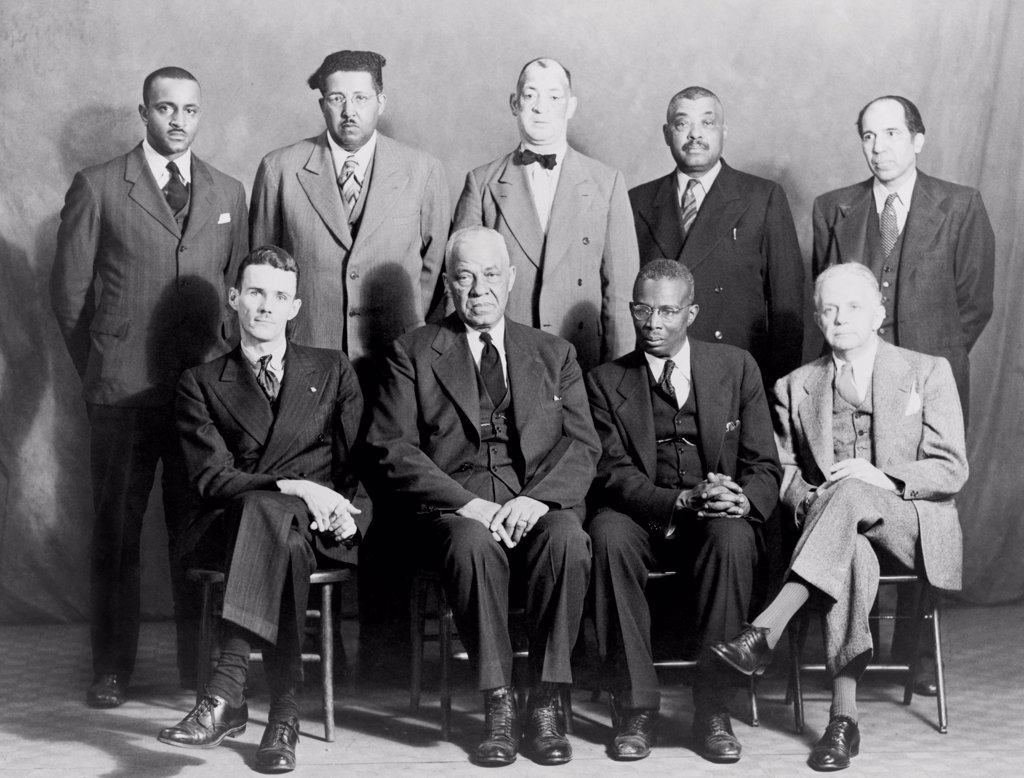 Stock Photo: 4048-10550 Five African American defendants and their NAACP counsel in Columbia, Tennessee 'Riot' case. Seated L-R: Maurice Weaver, Julius Blair, Alexander Looby, and Walter White. Standing left to right: James Martin, James Morton, Charles Blair, Saul Blair, and M.G. Ferguson. Ca. 1946.