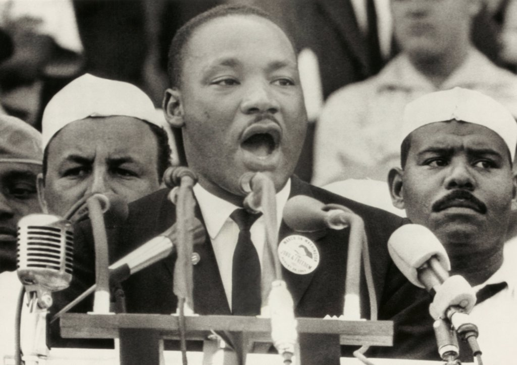 Stock Photo: 4048-10561 March on Washington. Martin Luther King delivers his famous 'I Have a Dream' speech from the steps of the Lincoln Memorial. Behind King are two Black Muslims who provided security in spite of Elijah Muhammad's call for a boycott of the demonstration. Aug. 28, 1963.