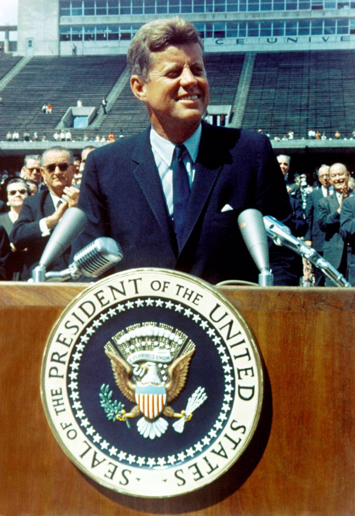 Stock Photo: 4048-10692 President Kennedy speaking at Rice University football field. Sept. 9, 1962. He called for 'no strife, no prejudice, no national conflict in outer space'. Sept. 9, 1962.