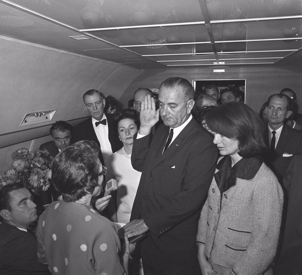 Stock Photo: 4048-10724 Lyndon Johnson takes the Oath of Office after Kennedy's assassination. This full frame high resolution digital image reveals detail of the iconic photograph.