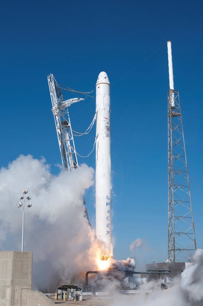 Stock Photo: 4048-10769 SpaceX's Falcon 9 rocket and Dragon spacecraft lift off from Cape Canaveral Air Force Station. The Dragon spacecraft completed two orbits, then splashed down in the Pacific Ocean. SpaceX is the first commercial company to successfully return a spacecraft from orbit. Dec. 8, 2010.