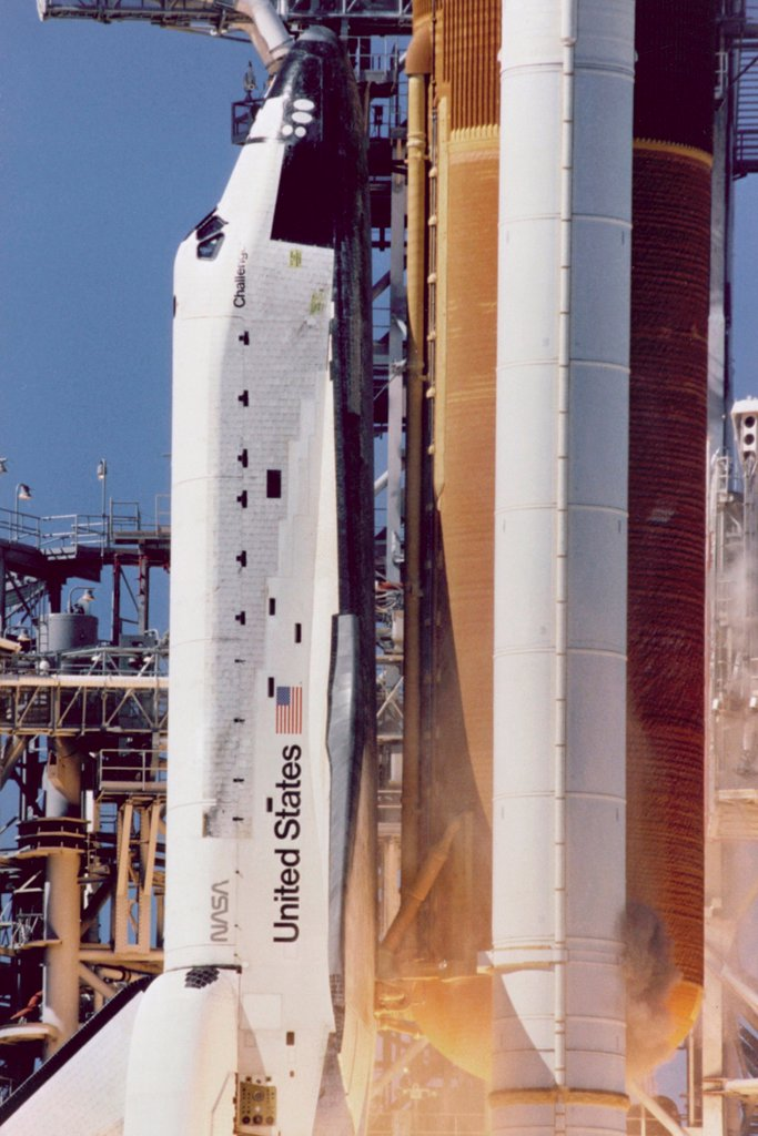 Stock Photo: 4048-10849 Space shuttle Challenger disaster. Grey-brown smoke on the right side of the Solid Rocket Booster, line directly across from the letter 'U' in United States, was the first visible sign a joint breach occurred. Jan. 28, 1986.