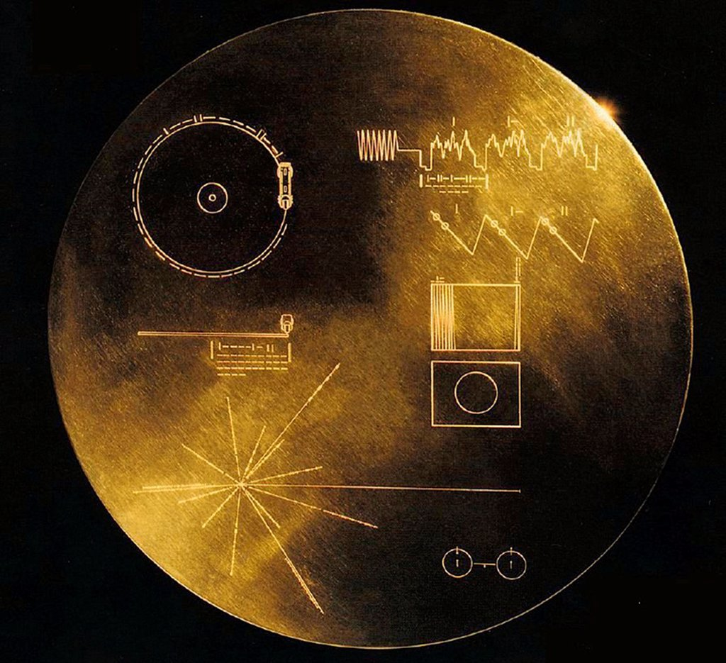 Stock Photo: 4048-10962 NASA's Voyager 1 and 2 spacecraft were launched in the 1977 and are still functioning, now 14 and 11.5 light-hours from the Sun. Each carries 12-inch gold plated copper disk of recorded sounds and images representing human cultures and life on Earth.