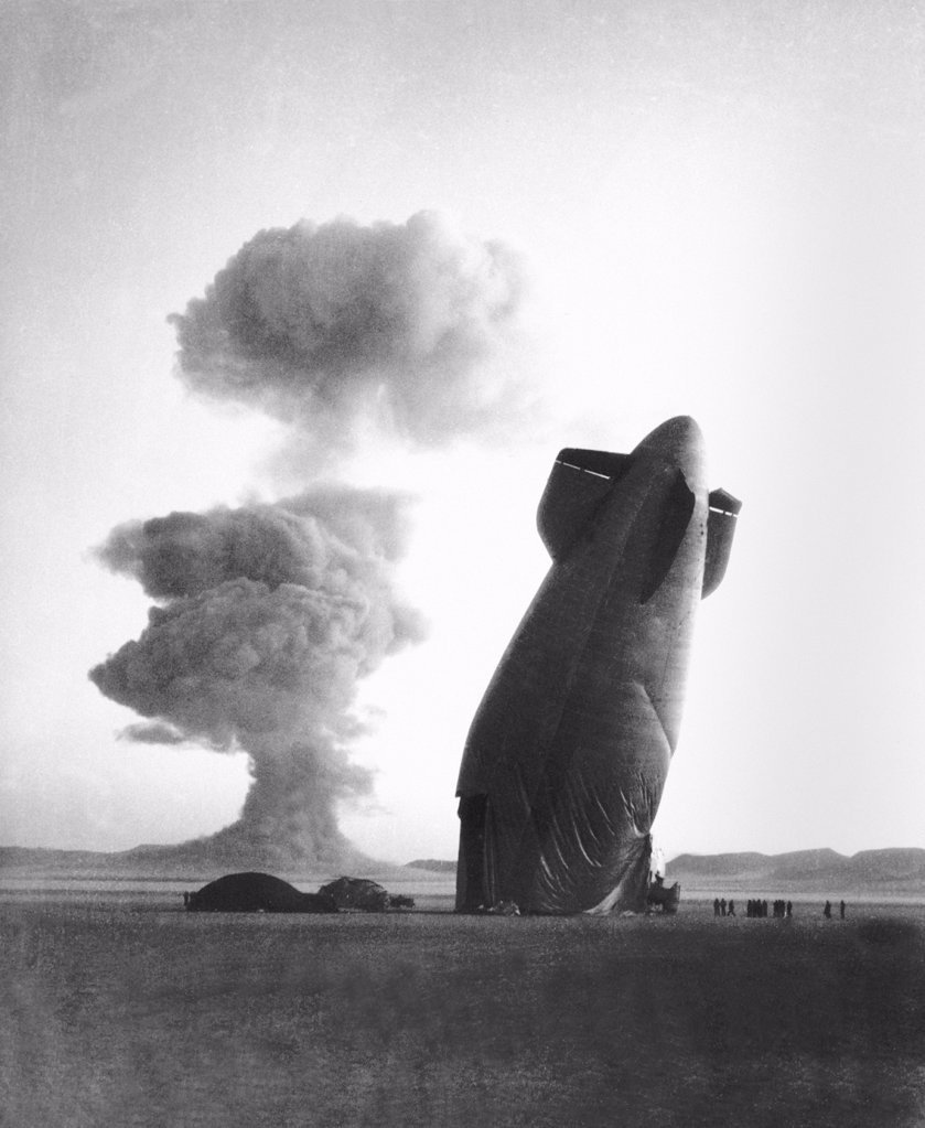 Stock Photo: 4048-10989 The STOKES shot was a 19 kiloton explosion detonated while suspended from barrage balloons. The wrecked Navy Goodyear Blimp had been in free flight over 5 miles form ground zero when destroyed collapsed by the blast's shock wave. Nevada test Site, August 7, 1957