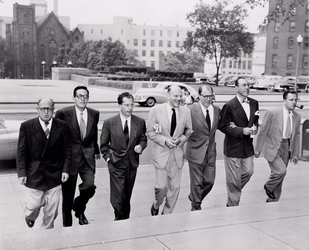 Hollywood writers go on trial. Seven Hollywood writers and directors arrive at court for trial on contempt of Congress. L-R: Samuel Ornitz, Ring Lardner , Albert Maltz, Alvah Bessie, Lester Cole, Herbert Bieberman, and Edward Dmytryk. They were charged for their defiance of the House Un-American Activities Committee (HUAC). June 20, 1950. : Stock Photo