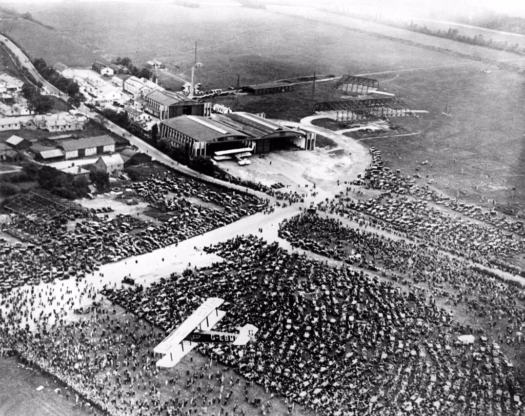 Stock Photo: 4048-1104 A view from the air of the huge crowds gathered at the Croyden Airdrome to greet Captain Charles A. Lindbergh when he flew the Spirit of St. Louis across the English Channel from Paris to England in 1927
