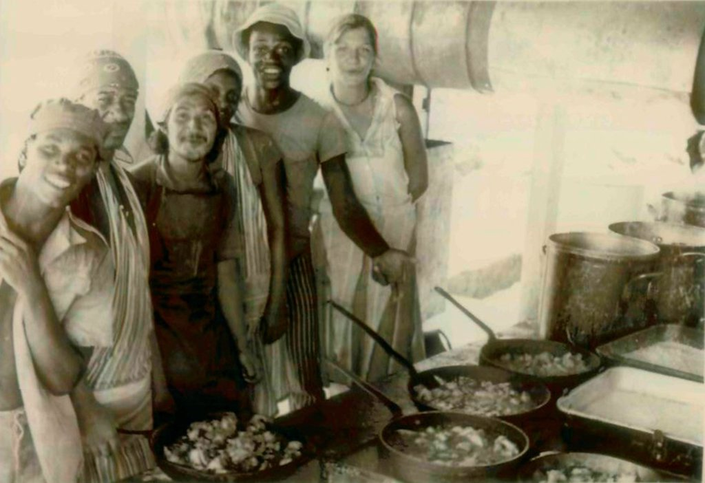 Stock Photo: 4048-11063 Kitchen workers at the People's Temple Agricultural Project. From back to front: Karen Harmes, Stanley Clayton, unidentified, Santiago Rosa, and two unidentified. Jonestown, Guyana. Nov. 1978.