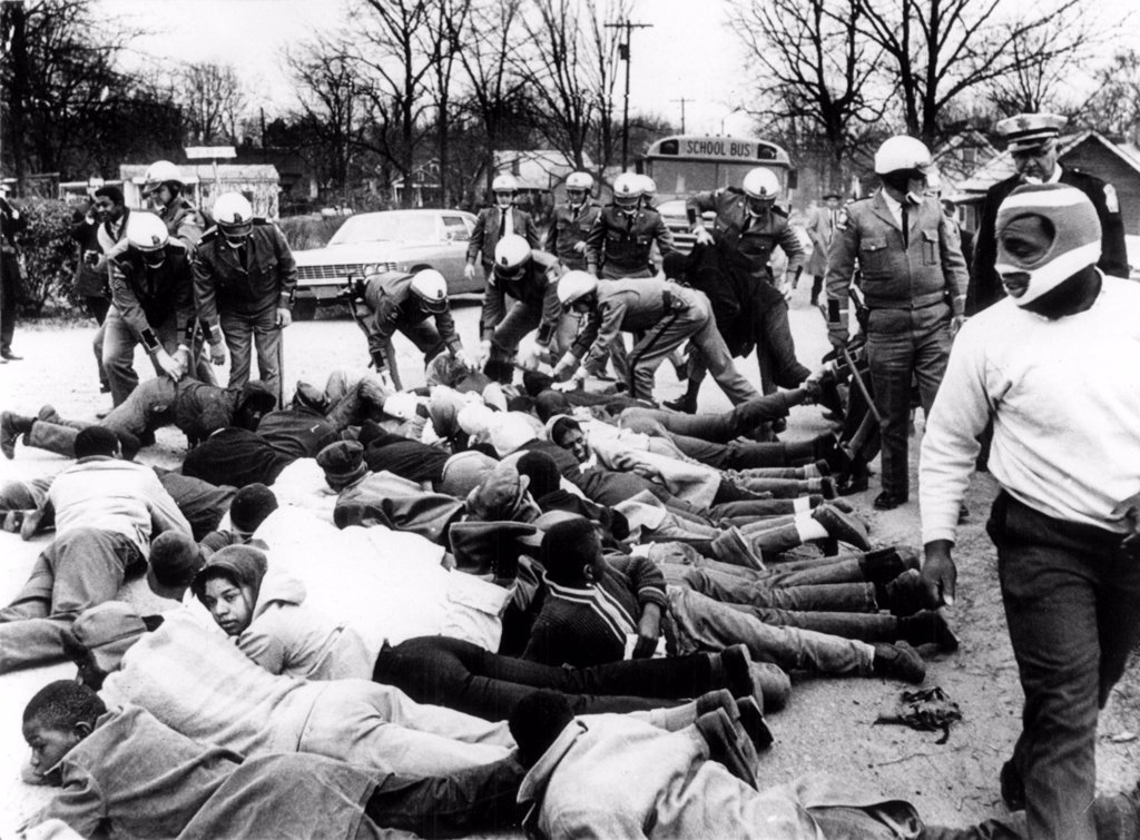 CIVIL RIGHTS, Social Circle, Georgia, State troopers arrest demonstrators blocking the path of a school bus protesting school conditions. February 15, 1968 : Stock Photo
