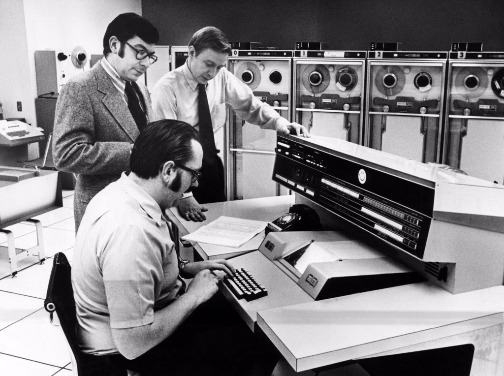 Stock Photo: 4048-1196 Officials at the main console of Univac 1108, 1972
