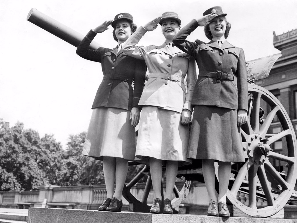 Gloria Pickett, Jane Greer (then Bette Jane Greer), and Inga Rundvold, modeling the uniforms to be worn by the Women's Auxiliary Corps, August 1942, Fort Des Moines, Iowa : Stock Photo