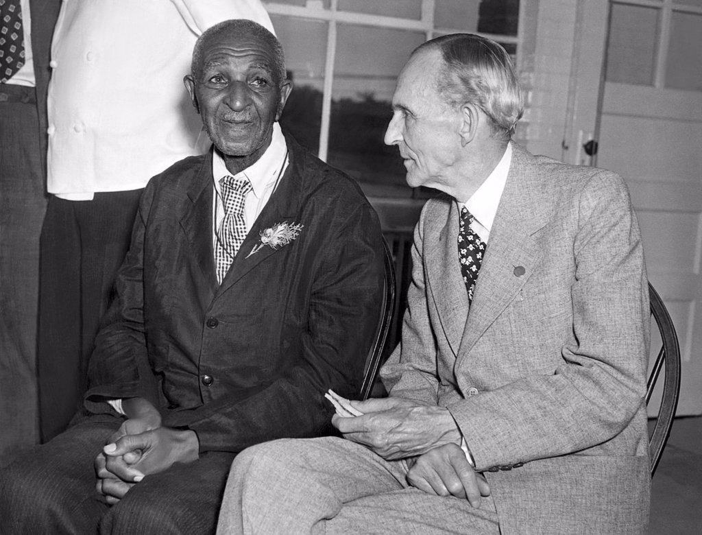 Stock Photo: 4048-1380 George Washington Carver signs up to do reseach at Ford Laboratories with Henry Ford, 1942