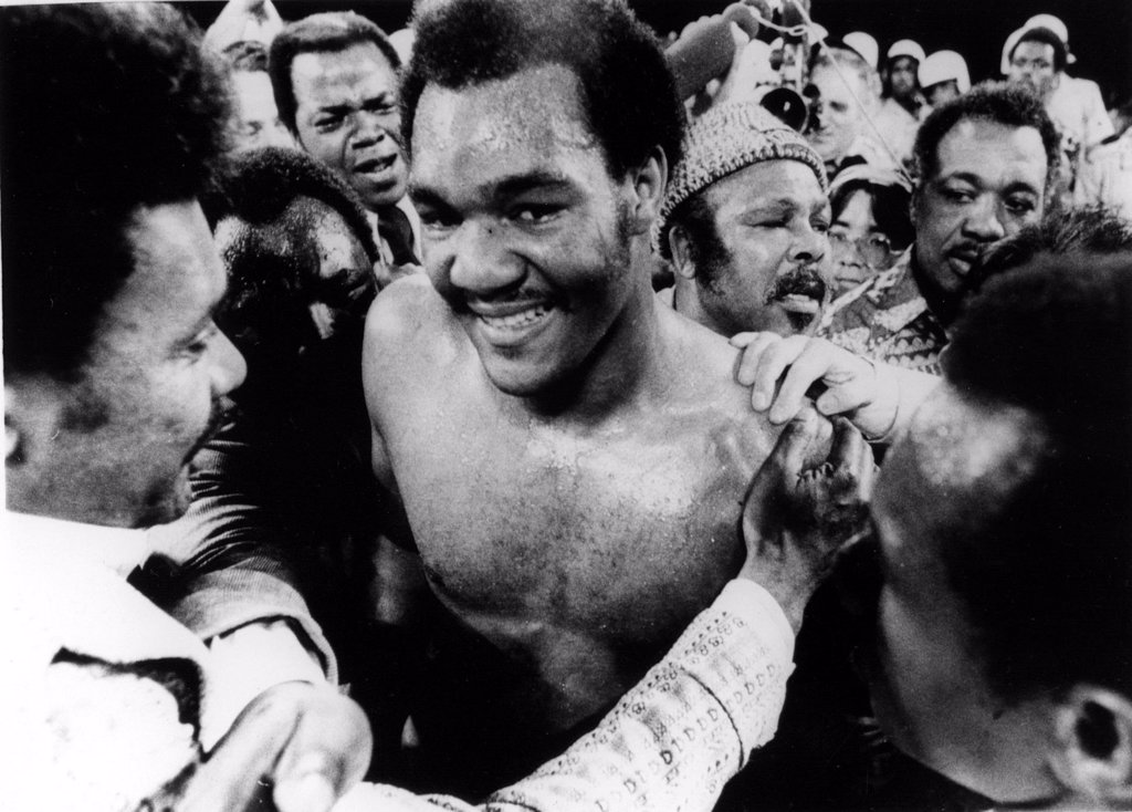 Stock Photo: 4048-1389 GEORGE FOREMAN- The boxer is congratulated in the ring after defeating Joe Frazier for the world heavyweight championship. Kingston, Jamaica 1/22/73