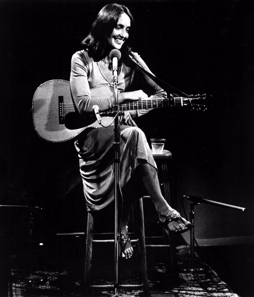 Stock Photo: 4048-1504 Joan Baez relaxes between songs during her special public television concert AN HOUR WITH JOAN BAEZ (TV, 1974)