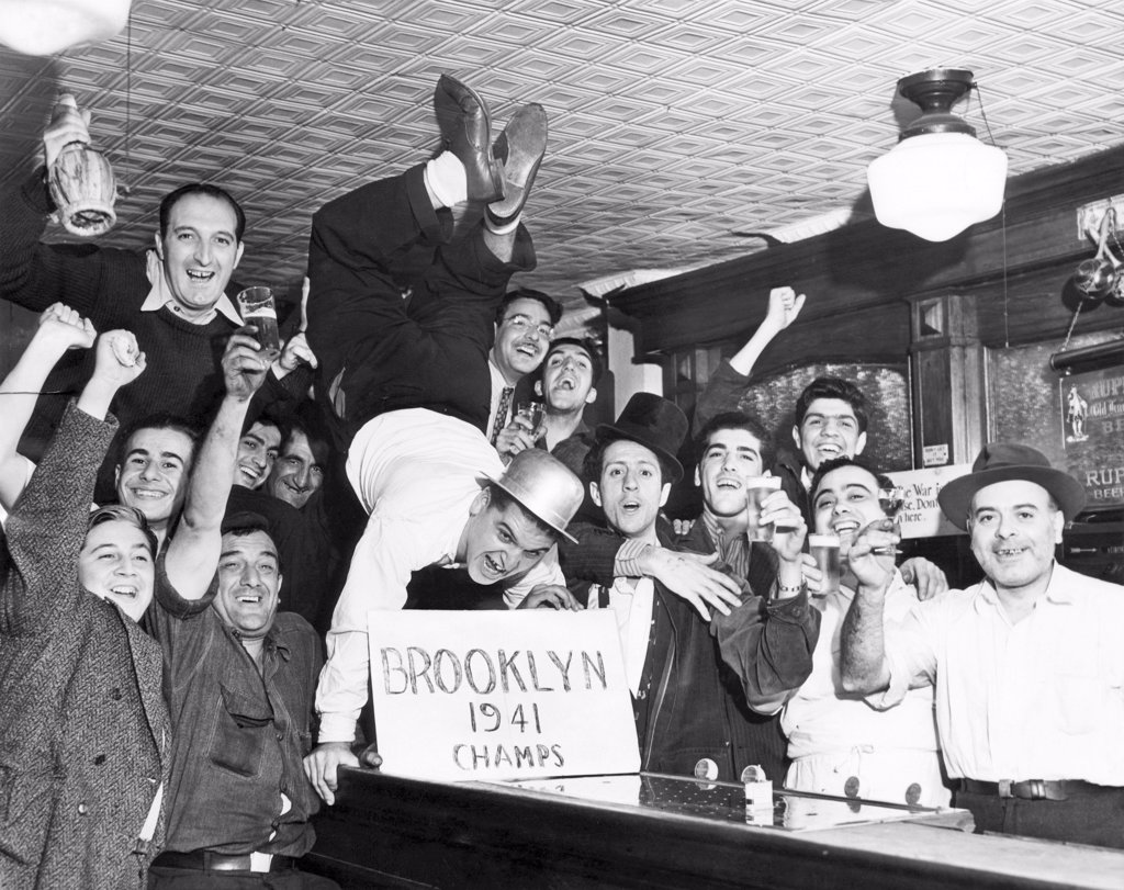 Fans cheer a Brooklyn Dodgers Pennant Victory in a bar on Withers Street. New York City, September 25, 1941 : Stock Photo