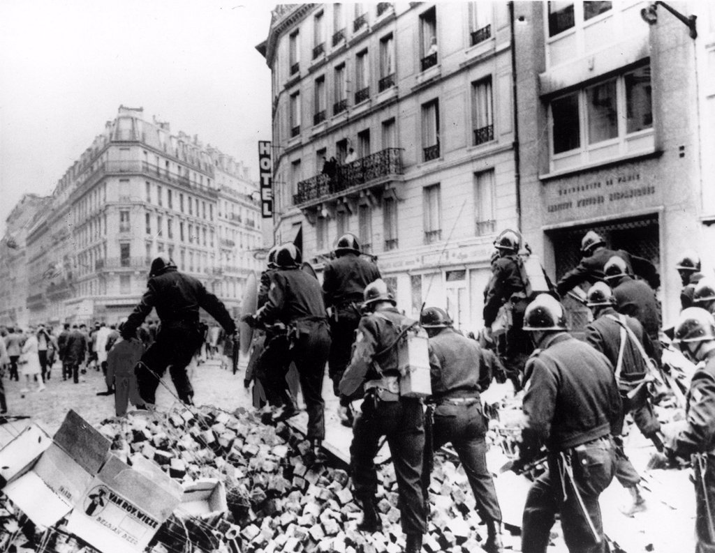 RIOTS-Riot police on barricade in the Latin Quarter of Paris during the riots of 1968. : Stock Photo