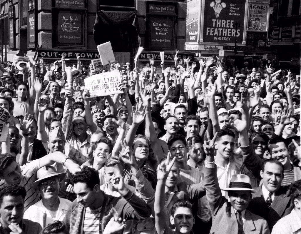 Stock Photo: 4048-2179 New Yorkers celebrating VJ Day and the prospect of an end to World War II, Times Square. The newspaper headline reads: 'Japs Will Yield If Emperor Stays', August 1945.