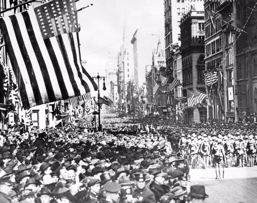 Returning U.S. troops marching up Fifth Avenue after the armistice and their return from France, New York, c. 1910's. : Stock Photo