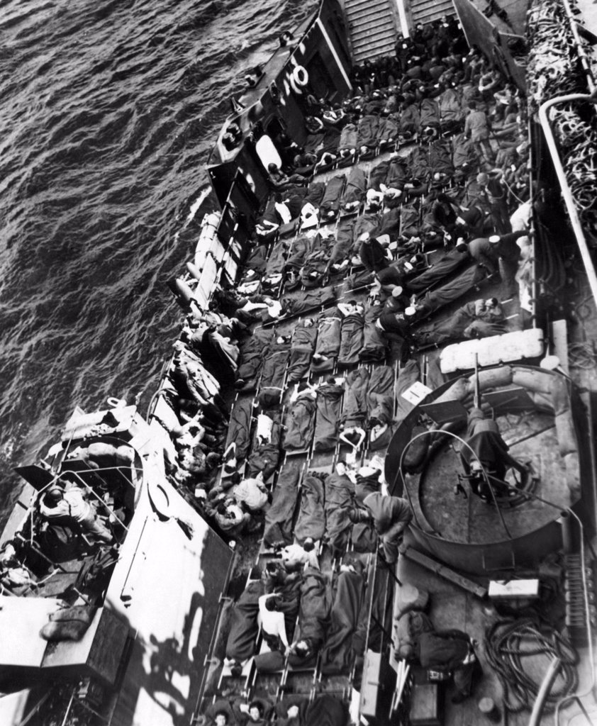 Stock Photo: 4048-2211 Wounded U.S. and British soldiers being taken away from the capture of Cherbourg, June 28, 1944
