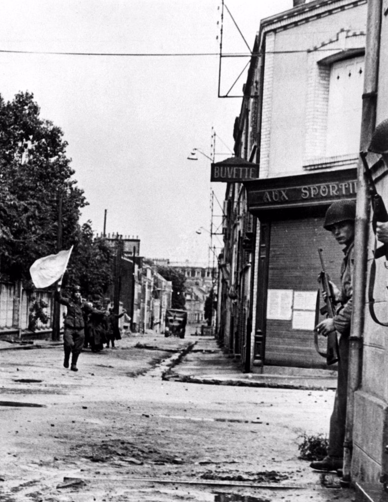 Stock Photo: 4048-2216 FRANCE--Defenders of a pillbox guarding a street in Cherbourg, German soldiers surrender, waving a white flag, after being knocked out of their position by allied tank fire. Soldiers in doorway of building at right keep guns on the ready on the lookout for any escape moves. Nazis carry their own wounded as they move defectedly in defeat with their