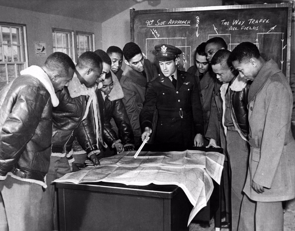Stock Photo: 4048-2226 Tuskeegee, Alabama: The U.S. Army's first all-Black air unit, the 99th Pursuit Squadron, instructed be Lt. Donald B. McPhereson. From left: Leeuel R. Custis, Mac Ross, Charles, DeBow, Frederick H. Moore, C.H. Flowers, Jr., George Levi Knox, Lee Rayford, Sherman W. White, Jr., George S. Roberts, and James B. Knighten, 1/23/42.