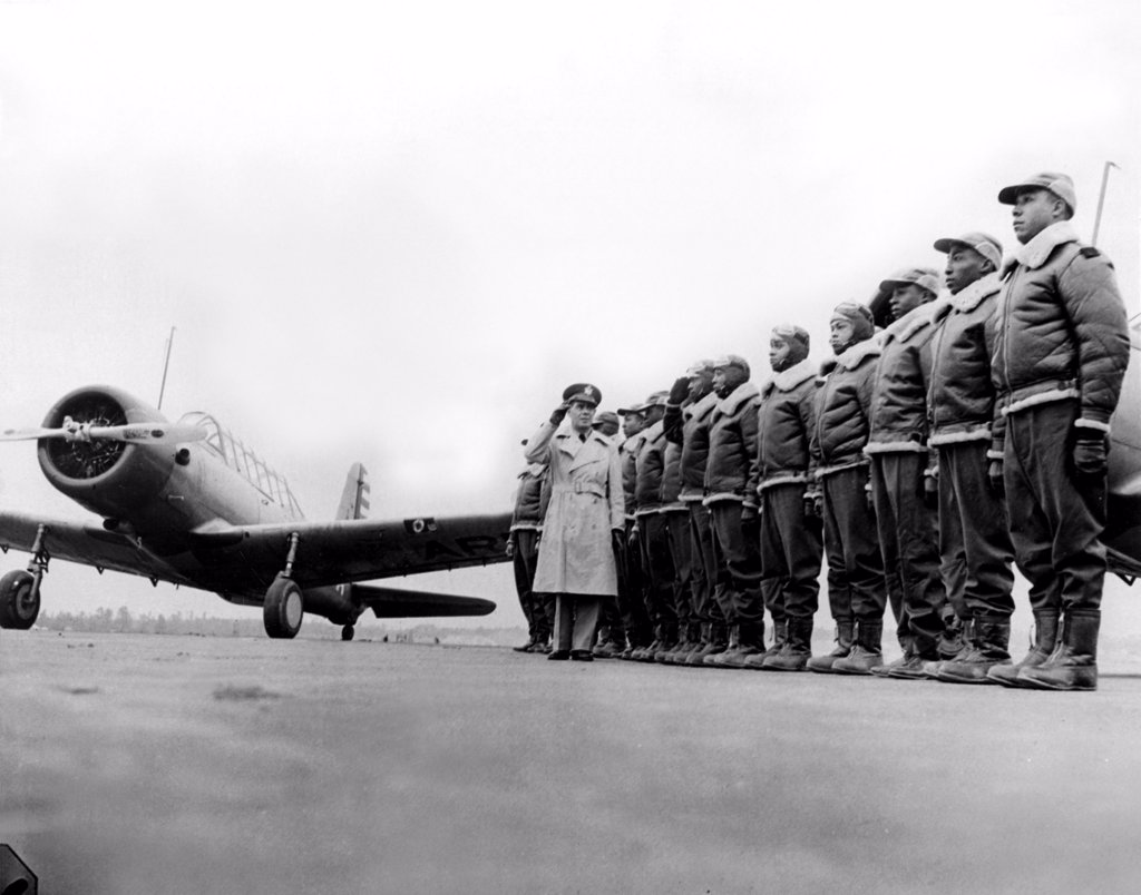 Tuskegee, Alabama: The 99th Pursuit Squadron. Major James A. Ellison returns the laute of Mac Ross, 1/23/42. : Stock Photo
