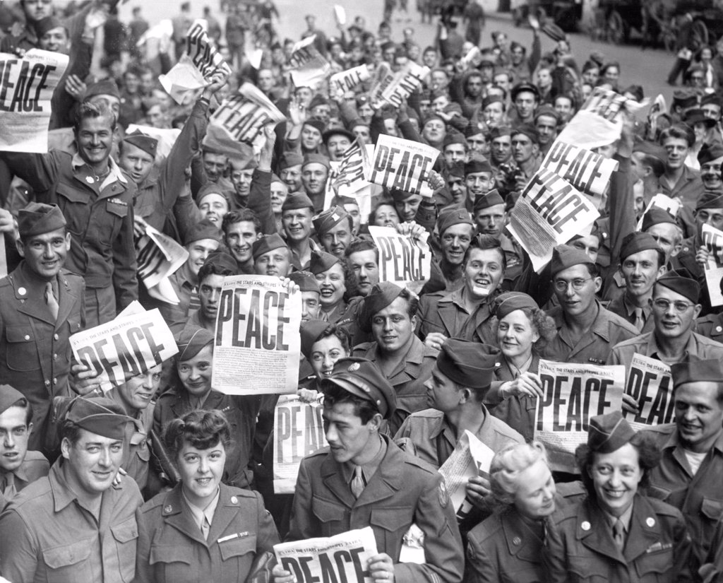 Service men and women send up cheers at news of Japanese capitulation, 9/2/45. : Stock Photo