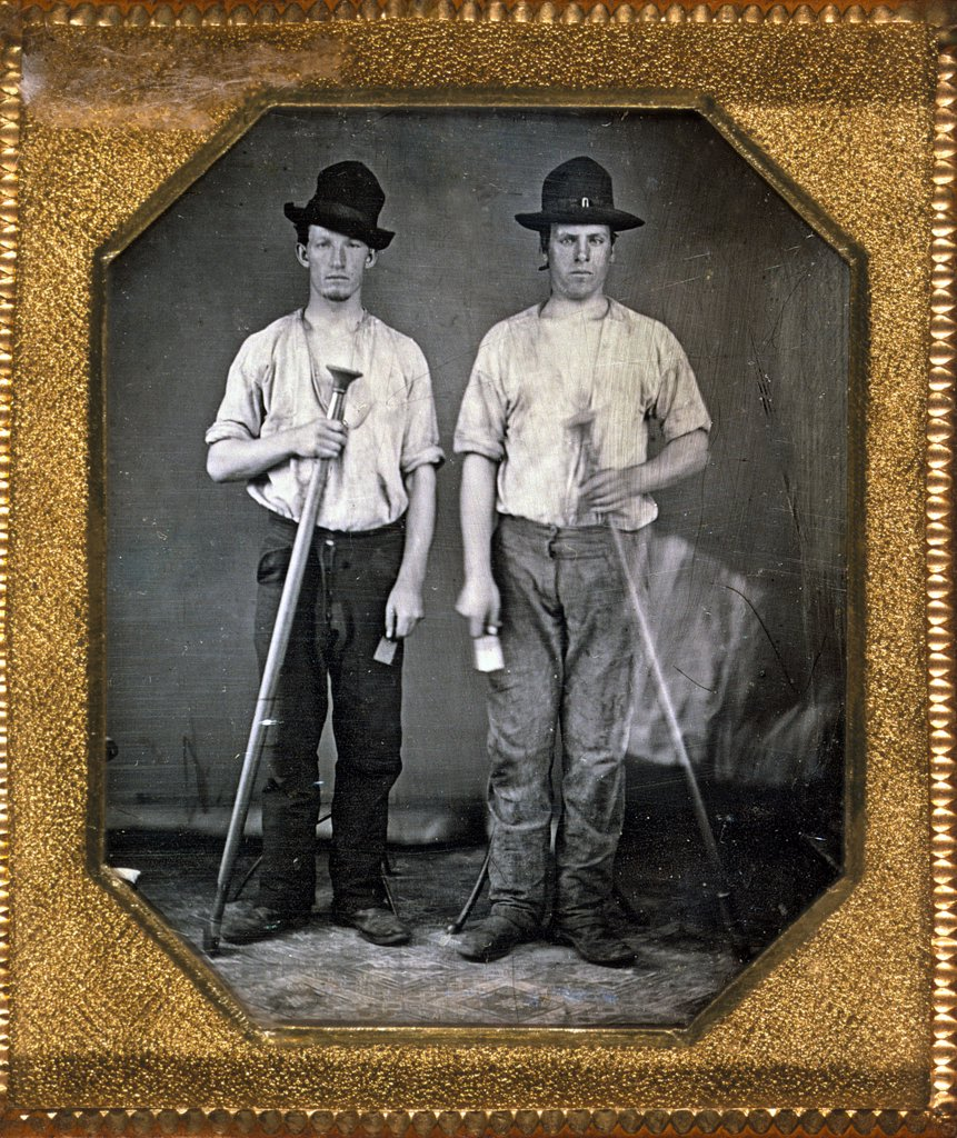 Two men holding floor rammers, foundry tools used for packing sand against molds, sixth-plate daguerreotype, with Eichmeyer variant case, circa 1850. : Stock Photo