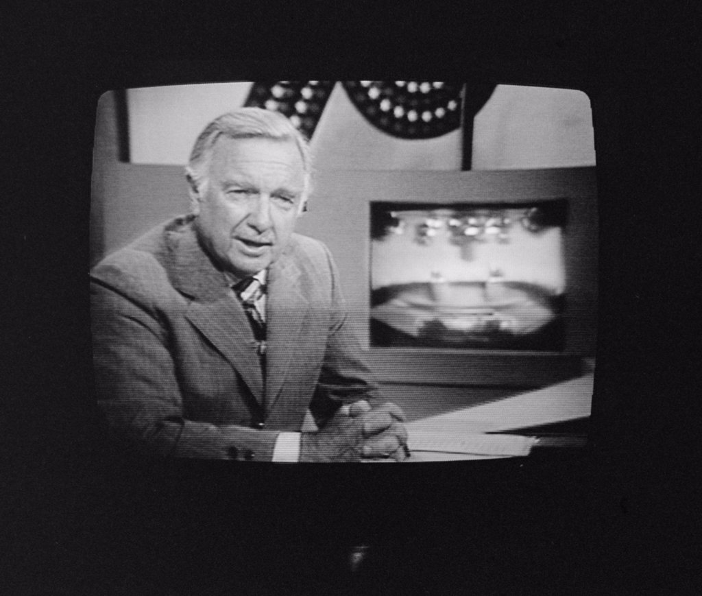 Walter Cronkite, American Journalist, on television during the 1st presidential debate between Gerald Ford and Jimmy Carter, in Philadelphia, Pennsylvania, photograph by Thomas J. O'Halloran, September 23, 1976. : Stock Photo