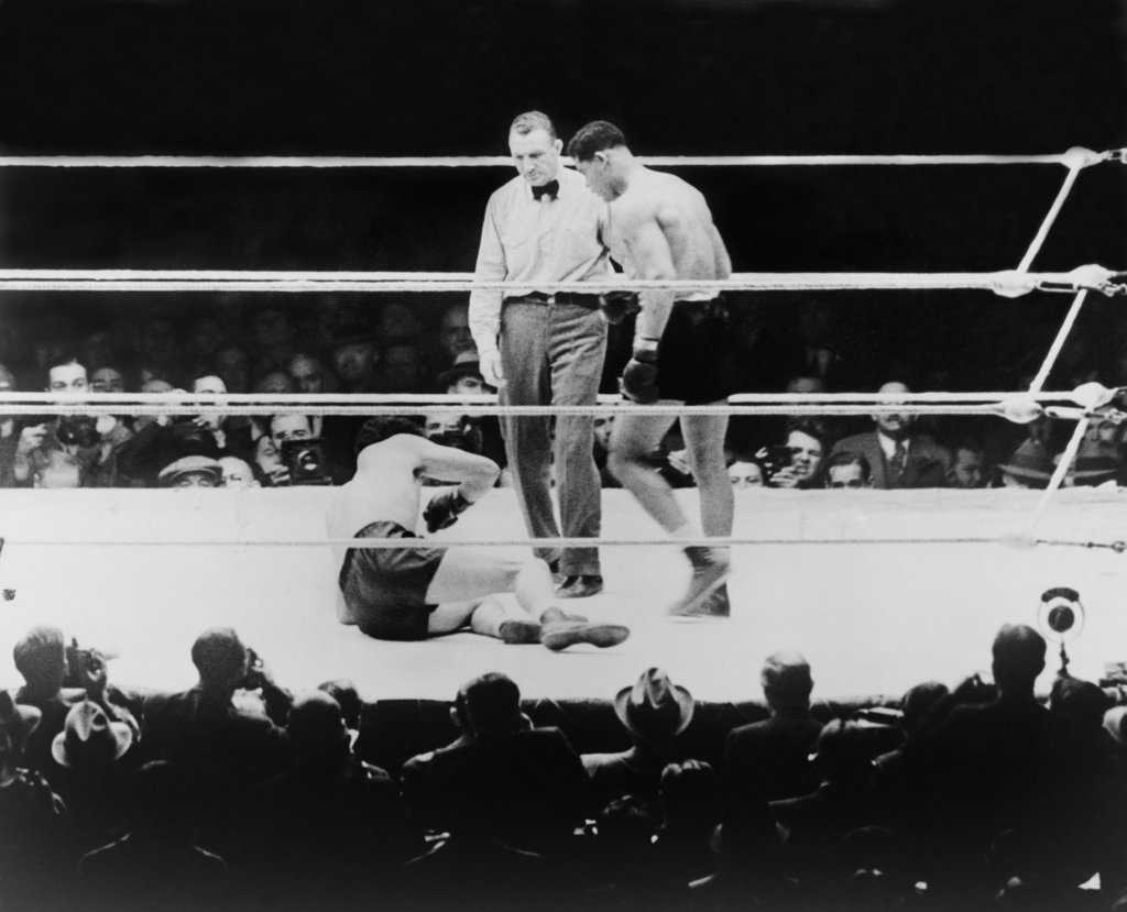 Max Baer (1909-1959), knocked down during a heavyweight fight with Joe Louis, September 24, 1935. Louis won by a knockout. : Stock Photo