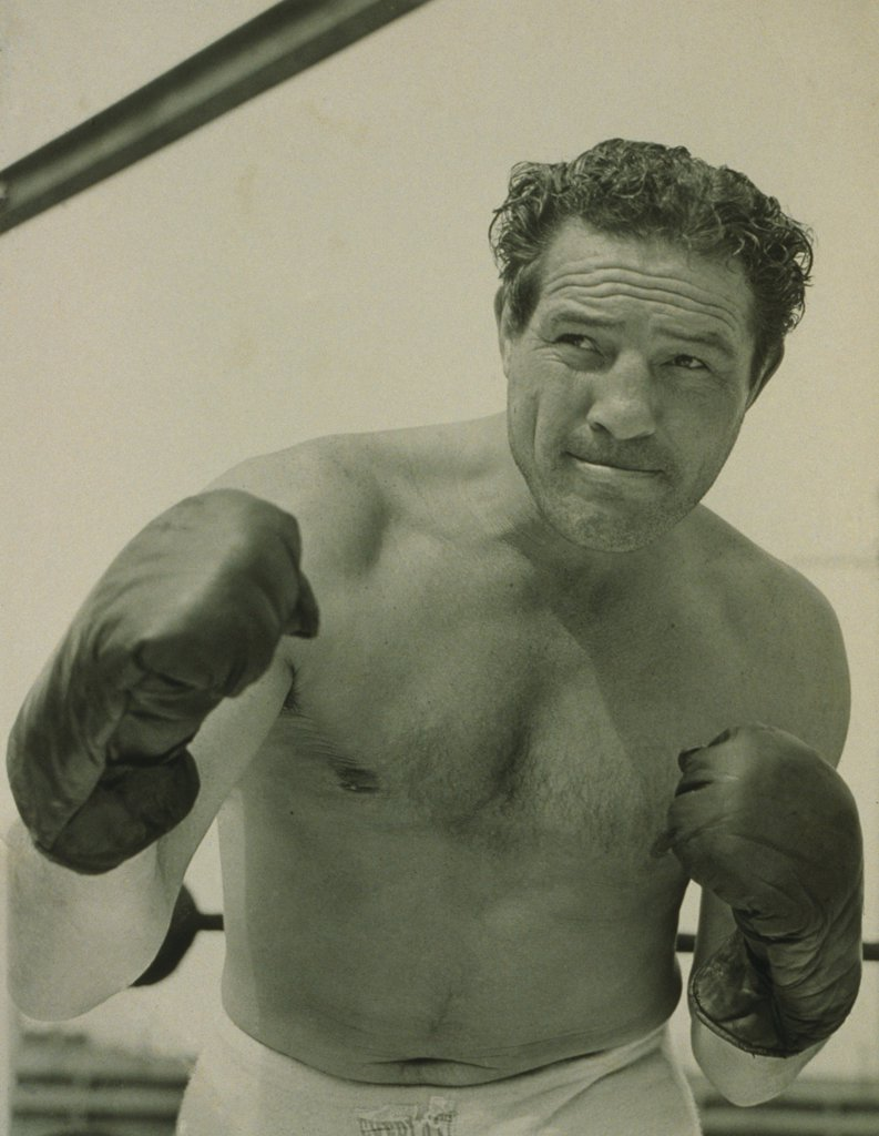 Max Baer (1909-1959), one-time Heavyweight Champion of the World, also worked as an actor, wrestler, and referee. THE PRIZEFIGHTER AND THE LADY of 1933 was the first of his 20 film performances. His son Max Baer Jr. is best known for his role as Jethro of the BEVERLY HILLBILLIES. : Stock Photo