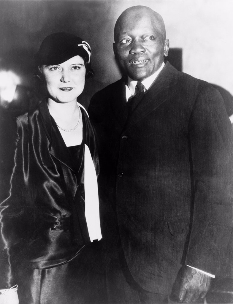 Former heavyweight boxing champion, Jack Johnson, with his fourth wife, the former Irene Pineau, at the opening of his night club, 'The Showboat,' Los Angeles, California. Oct 7, 1931. : Stock Photo