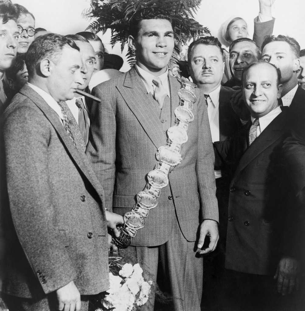 Stock Photo: 4048-5795 Max Schmeling (1905-2005), wearing heavyweight belt, flanked by his manager Joe Jacobs and Nat Fleischer (right), editor of the boxing magazine, RING.