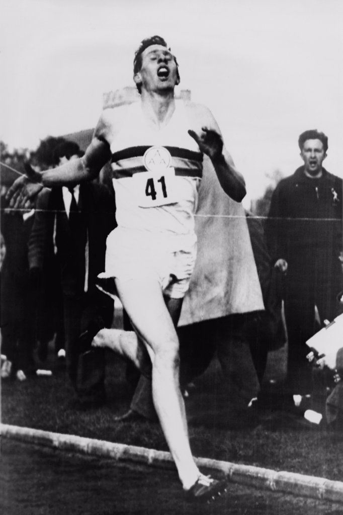 Stock Photo: 4048-5812 Roger Bannister crossing the finish line in three minutes and 59.4 seconds, achieving the four-minute mile, Oxford, England on May 6, 1954.