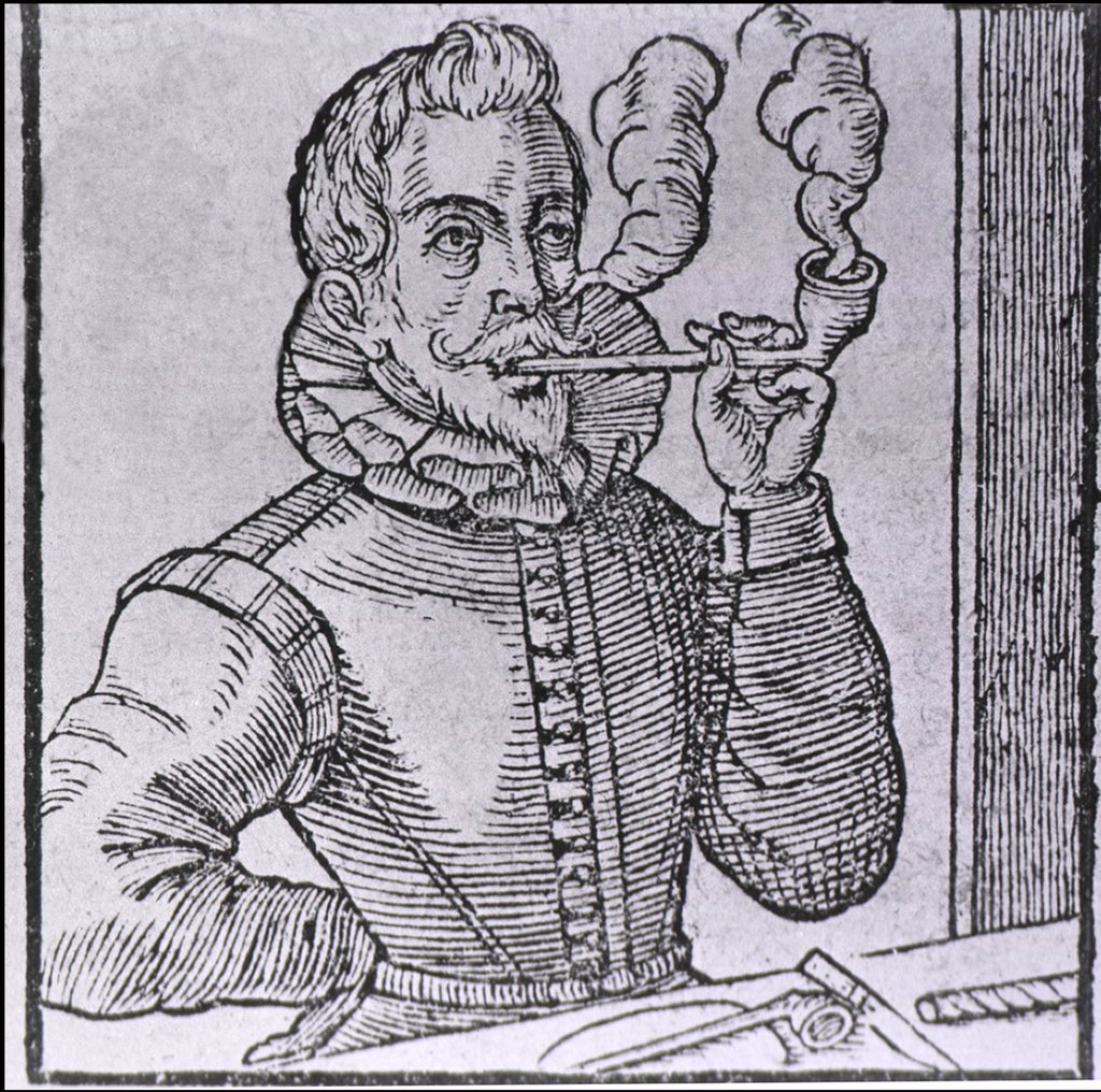 Stock Photo: 4048-5849 16th century Dutchman smoking a long-stemmed pipe, with another pipe and roll of tobacco on the table.  Pipe smoking was introduced to Europe in the 16th century by sailors returning from the New World. 1595 wood engraving.