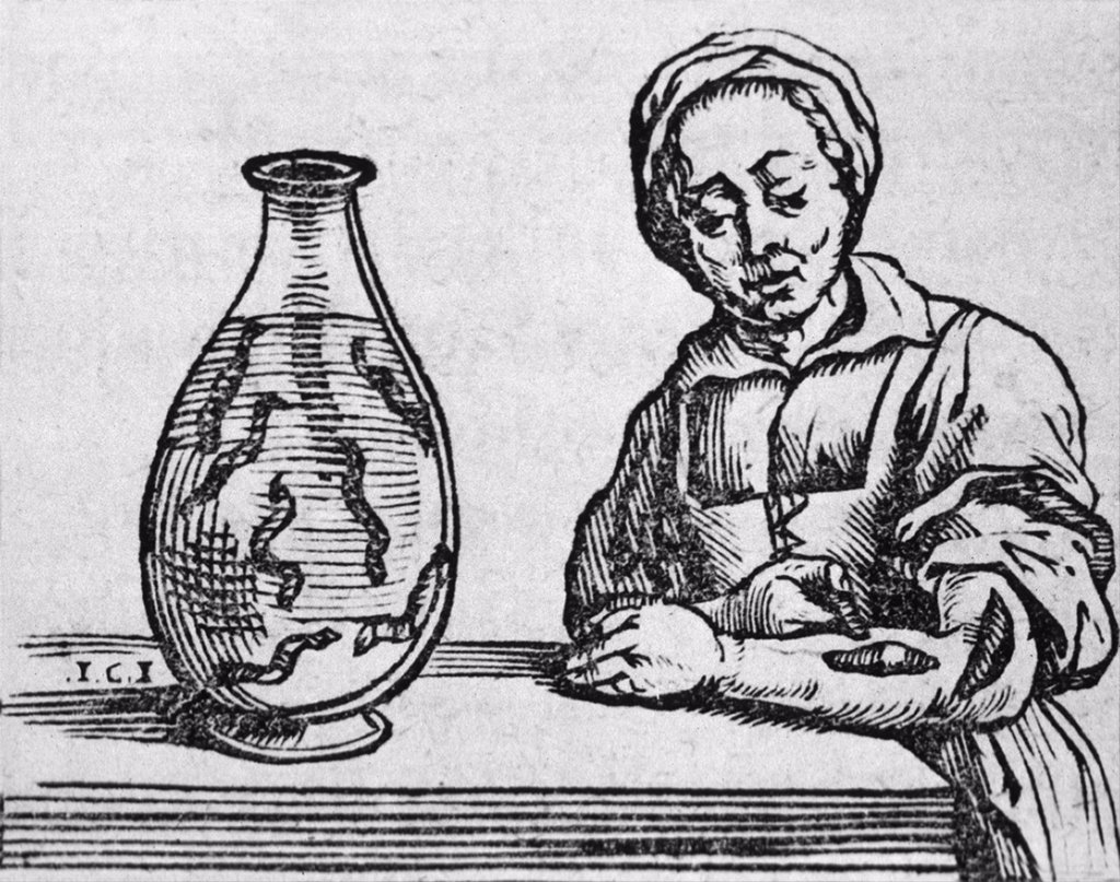 Stock Photo: 4048-5969 Woman applying a medicinal leech to her forearm, woodcut from a 1639 treatise by Belgian, Joannis Mommarti. Until the 20th century, Leeching was used to draw blood from the body, in a treatment similar to bloodletting.