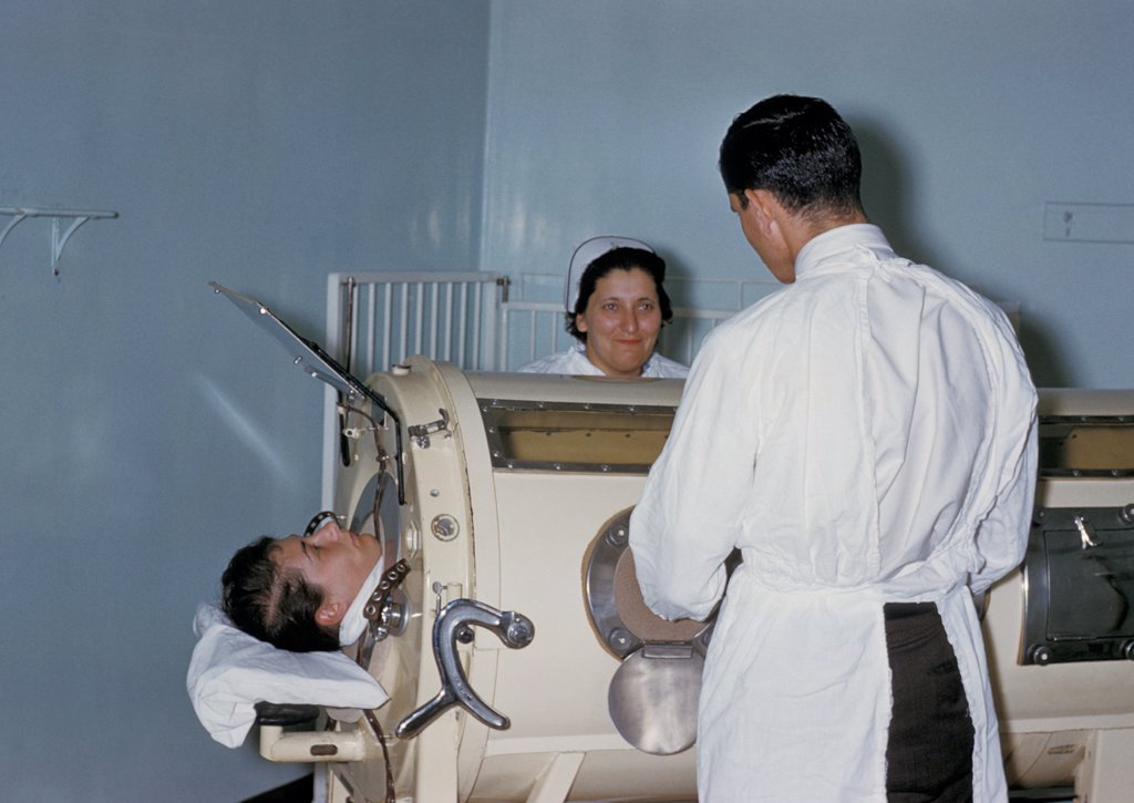 Stock Photo: 4048-6064 Hospital staff are examining a patient in a tank respirator