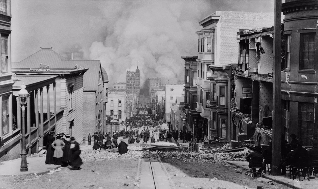 Stock Photo: 4048-6217 AFTER THE EARTH QUAKE, SAN FRANCISCO. Observers in chairs amid the debris on Sacramento Streetwatch the city burn. The fires, many caused by ruptured gas lines, lasted for 3 days and  were more destructive than the earthquake and its aftershocks. Photo by Arnold Genthe.