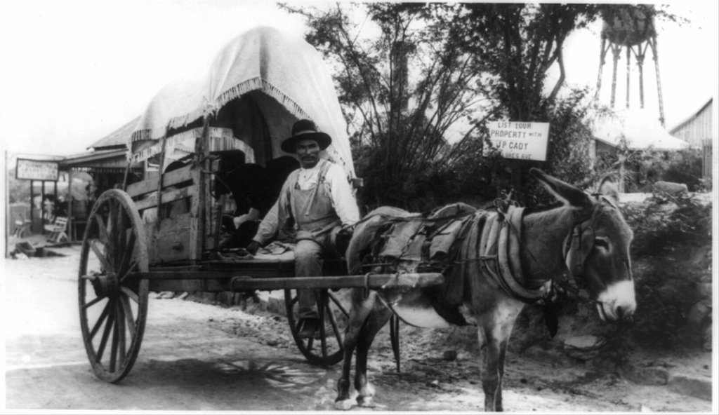 Mexican man on a donkey cart emigrating to the United States via Nuevo Laredo, directly across the Rio Grande River from Laredo, Texas. Ca. 1912. : Stock Photo