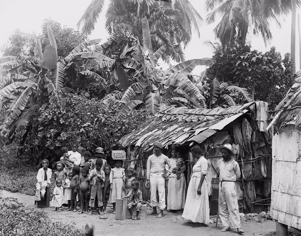 Puerto Ricans in front of a primitive dwelling shortly after Puerto Rico was annexed by the United States after the Spanish American war. Ca. 1903. : Stock Photo