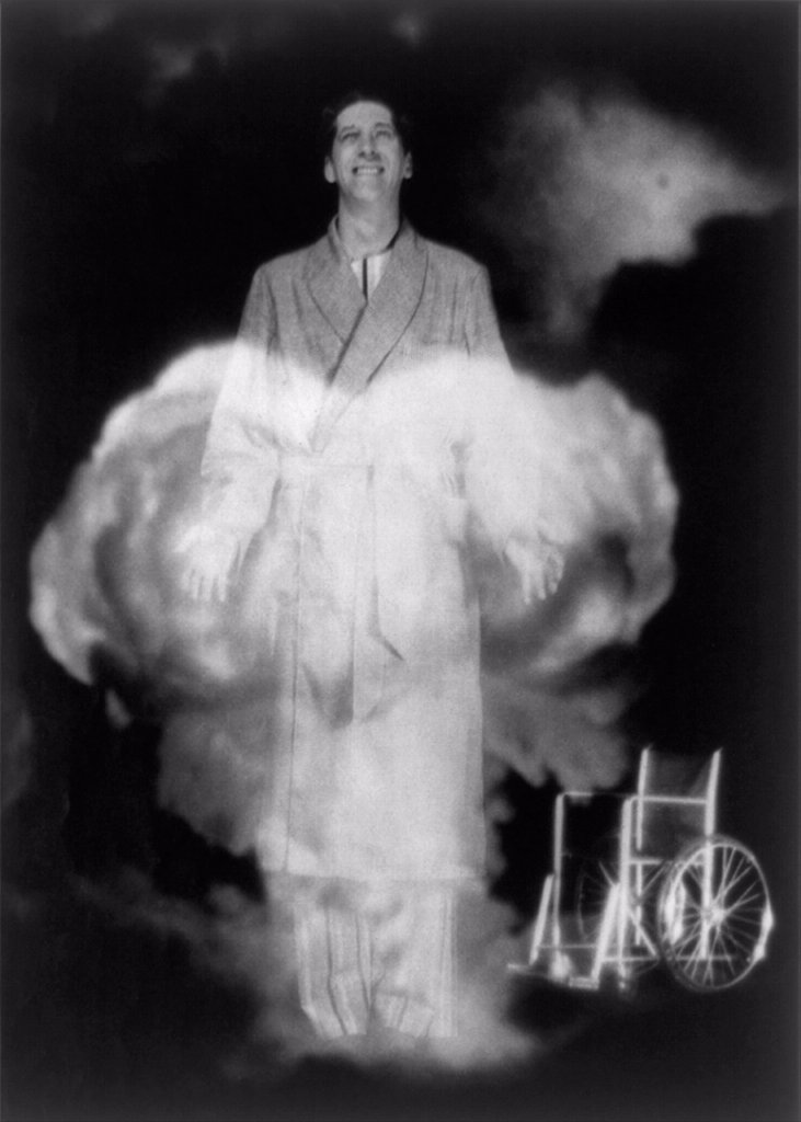 Atomic energy was imagined to have miraculous curing power when introduced in the 1940s. An illustration from a 1947 COLLIER'S magazine in depicted a recovered paraplegic smiling from a mushroom cloud, his abandoned wheelchair in the background. : Stock Photo