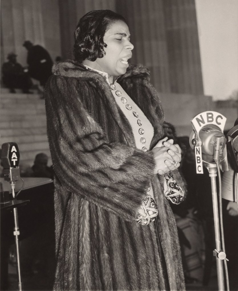 Stock Photo: 4048-6915 Marian Anderson (1897-1993), at a NBC microphone during her historic concert on the steps of the Lincoln Memorial, singing to a crowd of 75,000 on Easter Day, April 9, 1939. The concert was a landmark event in the African American civil rights struggle.