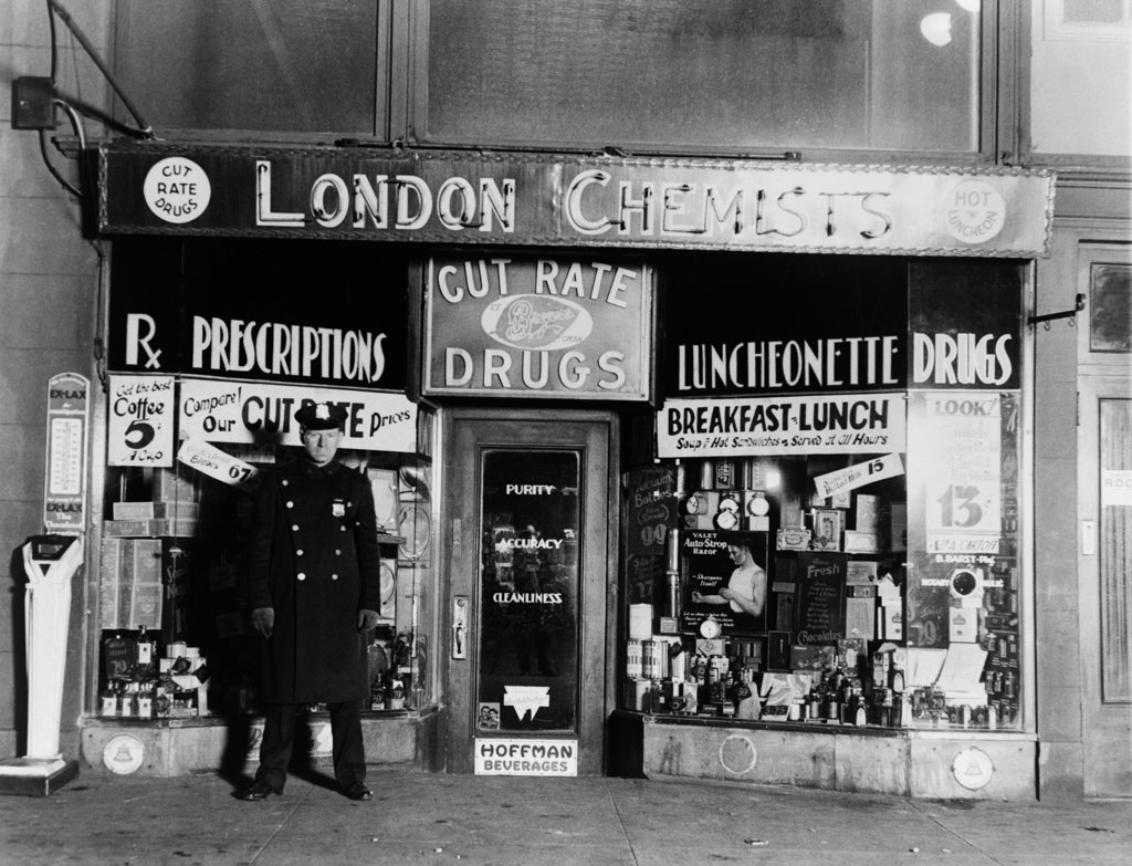 A New York City policeman guarding the crime scene where gangster Vincent Coll was murdered by Dutch Schultz's assassins at Eighth Avenue and 23rd Street.   February 8, 1932. : Stock Photo