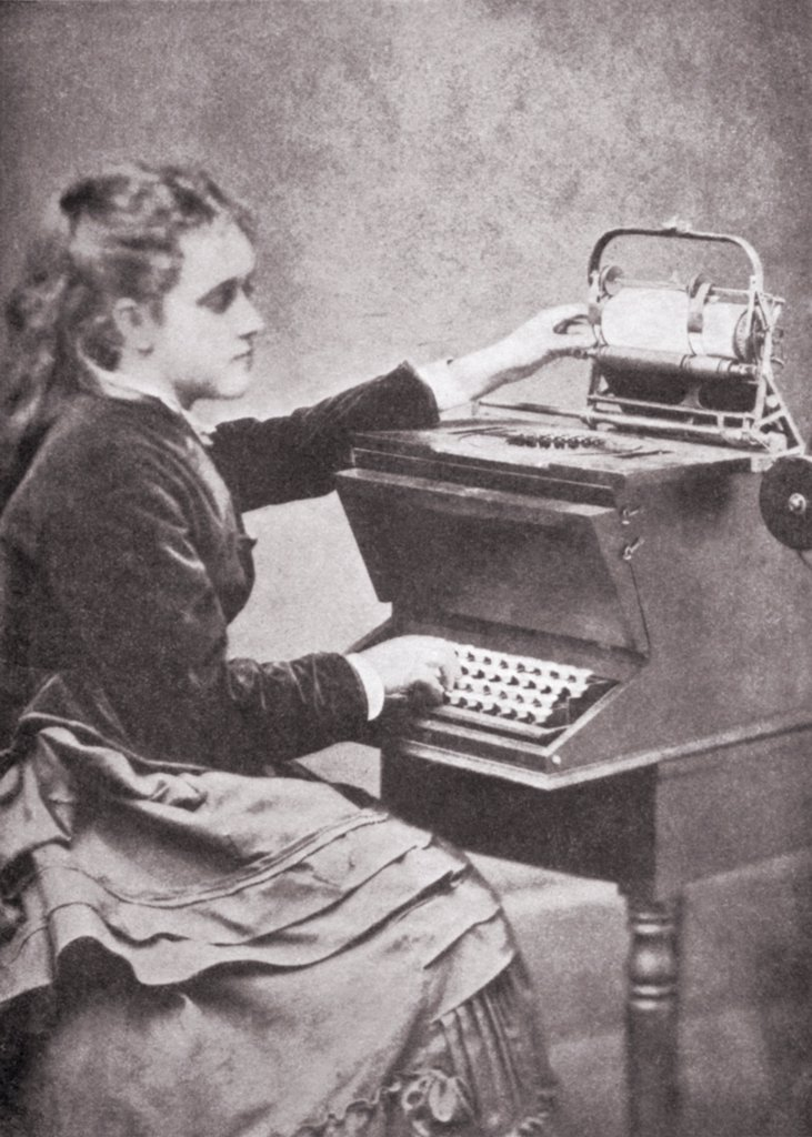 The daughter of inventor Christopher Sholes writing on one of his experimental typewriters in 1872. : Stock Photo