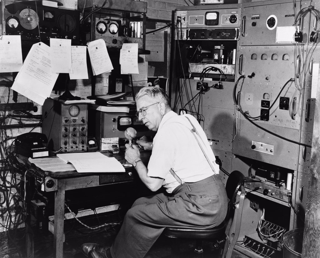 Stock Photo: 4048-7169 Ted Gempp, operator of the radio station at Alpine, N.J., at microphone in the control room of the station. 1948.