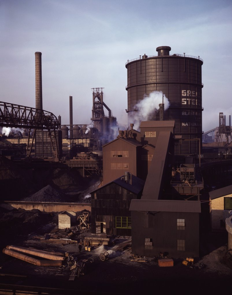 Hanna furnaces of the Great Lakes Steel Corporation, Detroit, Michigan. The tank stores gas from the coke oven. Square building and extension in middle ground is where coal is fed to the coke oven. : Stock Photo