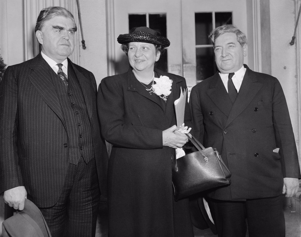 John L. Lewis, President of the C.I.O., Francis Perkins, Secretary of Labor, and James Dewey, Labor Department conciliator after a conference with President Roosevelt to discuss a coal industry labor dispute. May 9, 1939. : Stock Photo
