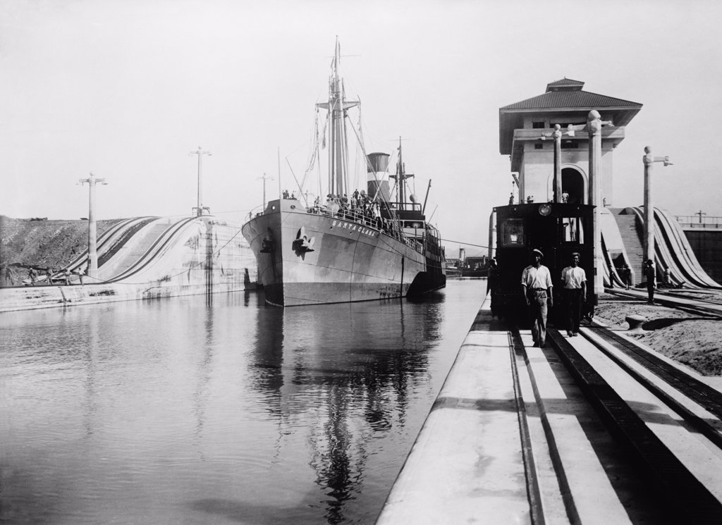 Stock Photo: 4048-7645 Ship moves through the Miraflores Lock of Panama Canal, ca. 1915.