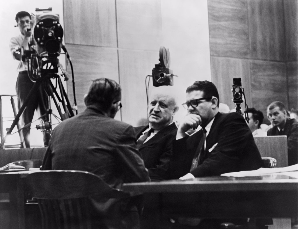 Stock Photo: 4048-7705 Television cameras filming Billie Sol Estes right conferring with his attorneys during his fraud trial for receiving millions of agricultural subsidies. The highly connected Texas Democrat successfully argued that camera coverage of the trial deprived